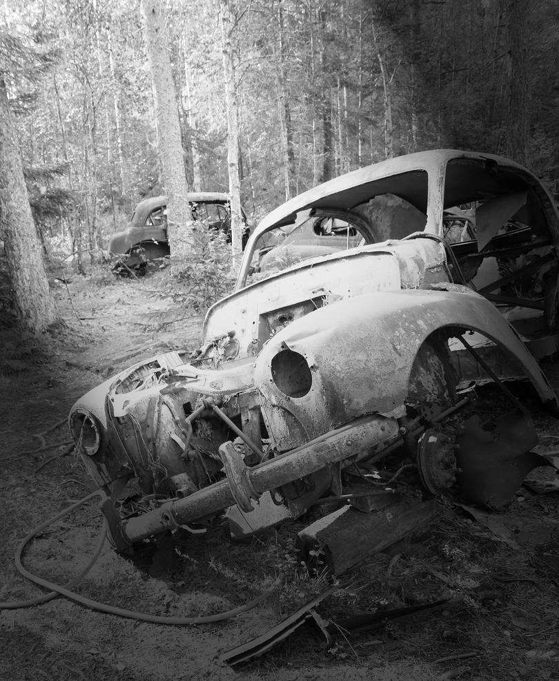 Car graveyard by ~POPMYCORN on