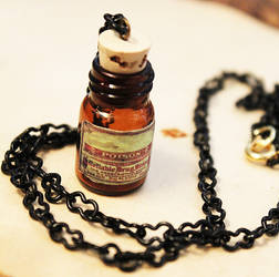 Amber Poison Bottle Necklace 2 by asunder
