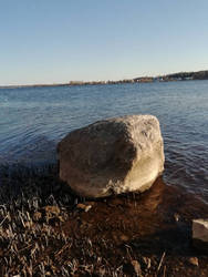 Big stone on the river bank