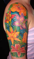 sheena's flower arm tattoo