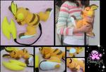 Cuddling Raichu plush