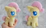 Tiny baby Fluttershy plush