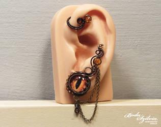 Dragon eye ear wrap by bodaszilvia