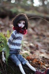 Cute Girl in the Woods Looking for the Wolf