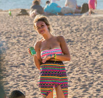 Candid beach girl winking at you