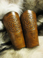 Brown Celtic Bracers by AThousandRasps