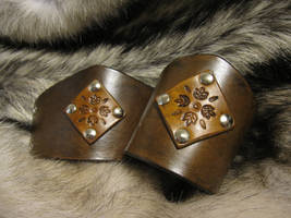Brown Leaf Cuffs by AThousandRasps