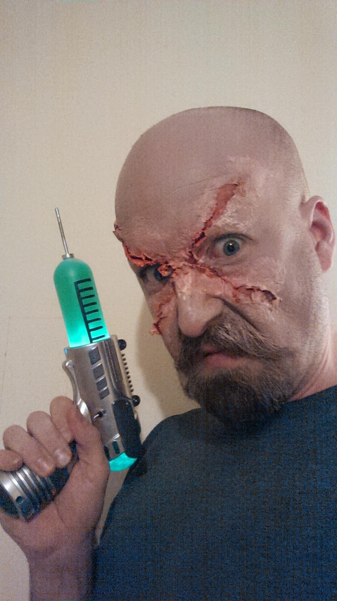 makeup test for antagonist with syringe gun prop by Handcuffknot