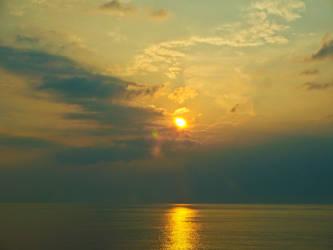 Ocean Sunsets by Caeruleus-Femella