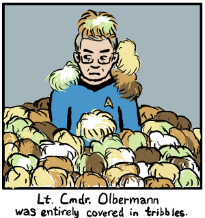 Lt. Cmdr. Keith Olbermann, buried up to the elbows in tribbles (with another couple on his head and shoulders), looking extremely grumpy about the situation, with the caption 'Lt. Cmdr. Olbermann was entirely covered in tribbles.'