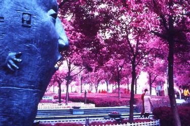 Metal Face Sculpture In Shanghai Park by vanfoto