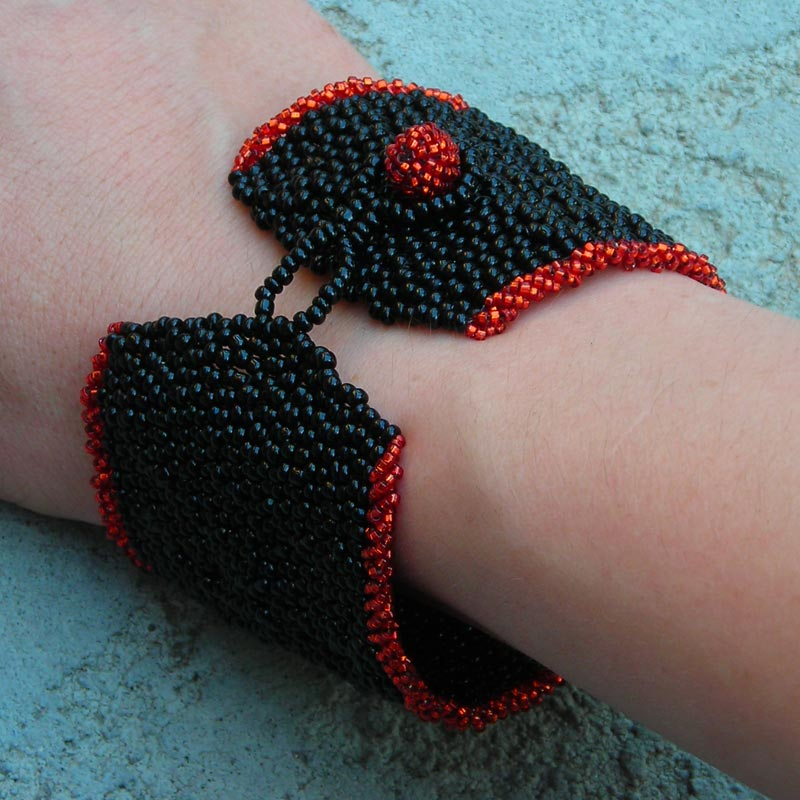 black and red woven beaded bracelet