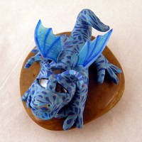 Blue and Silver Winged Dragon by BrightEyedCreatures