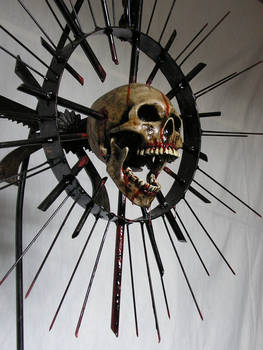 SPIKY SKULL SCULPTURE