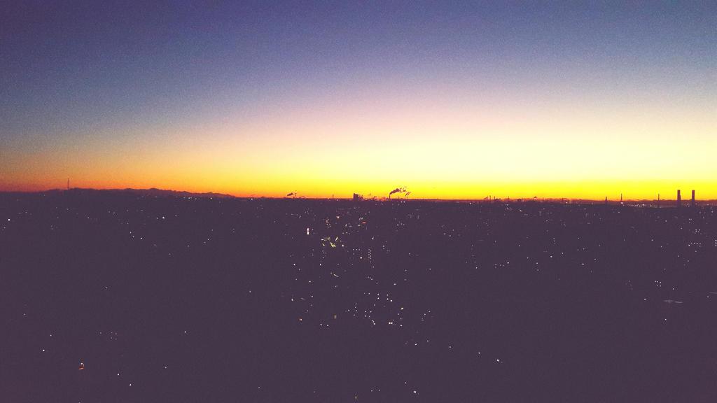 Sunrise over Shinyokohama by nyeinayehtetsan