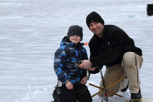 Sons first fish ice fishing with Dad