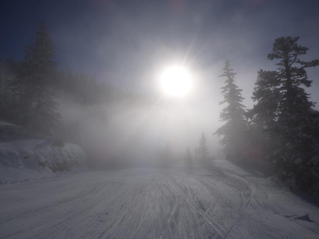 Sun crossing clouds in winterscape by A1Z2E3R