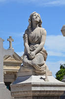 Grave statue of Knelt down young woman