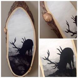 Deer Silhouette on wood slab