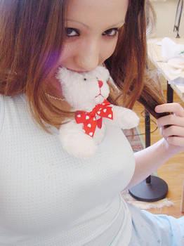 my poor mini teddy under dental attack lol
