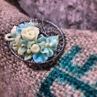 green flower brooch