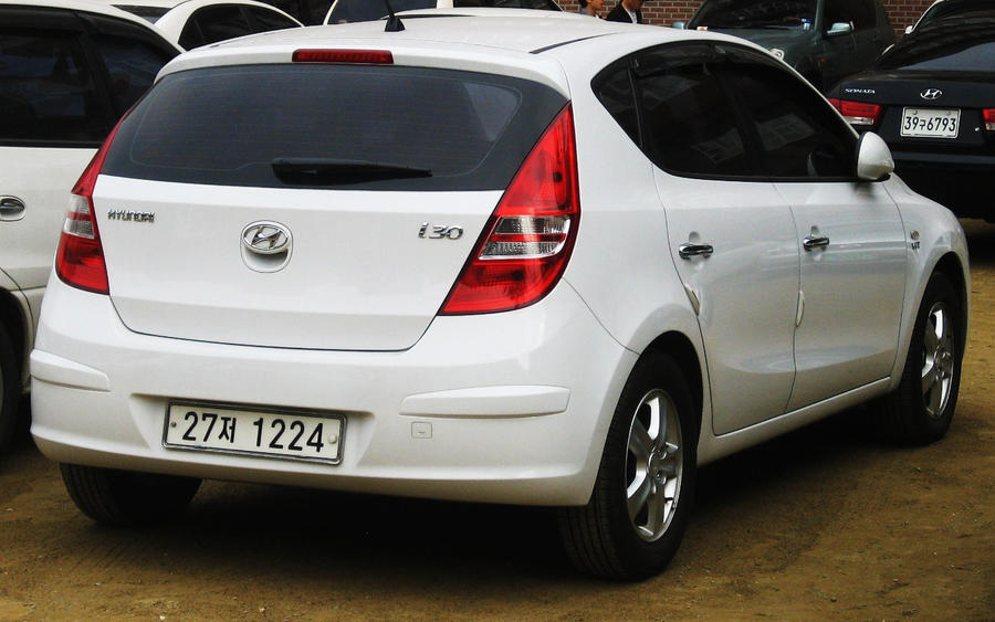 hyundai i30 rear view white by kia motors. Black Bedroom Furniture Sets. Home Design Ideas