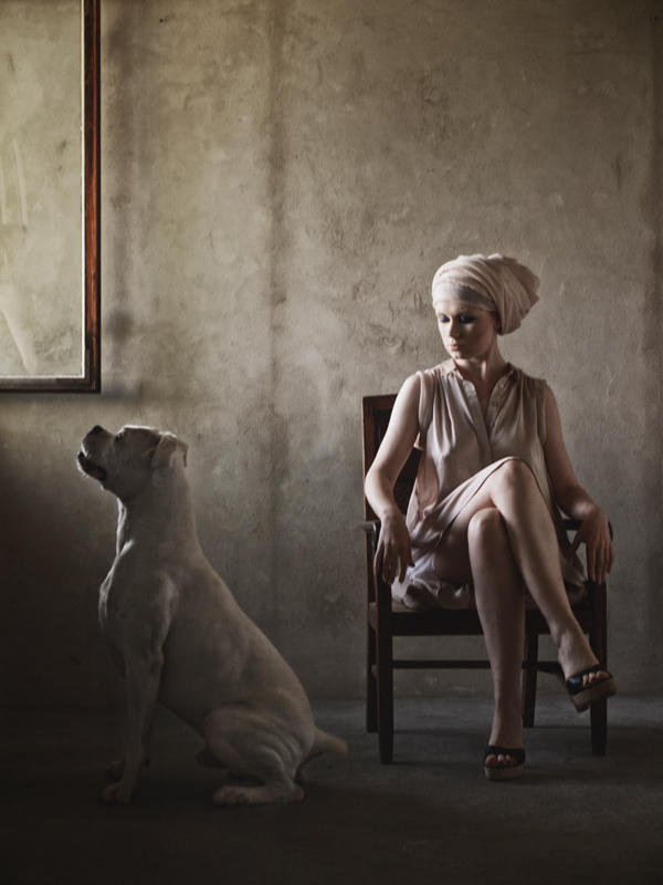 Women with the dog by an open window