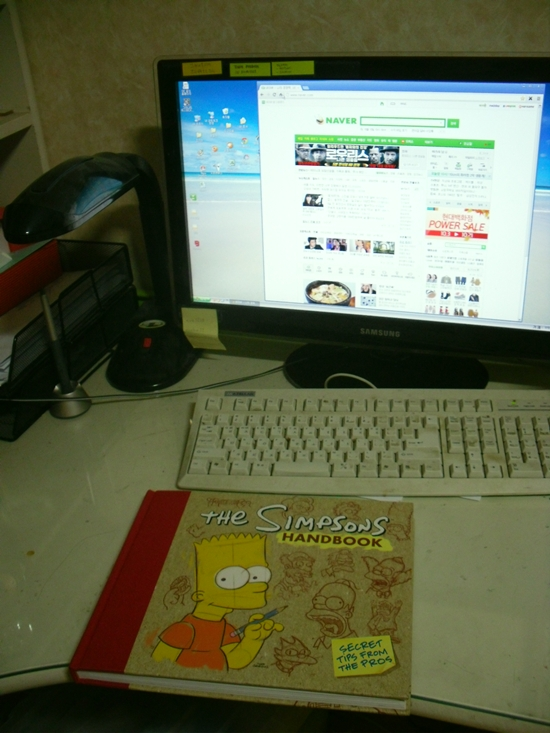 My desk and Simpsons Handbook by Matsuri1128