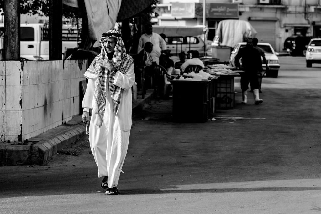Man walking by fish market by bad95killer