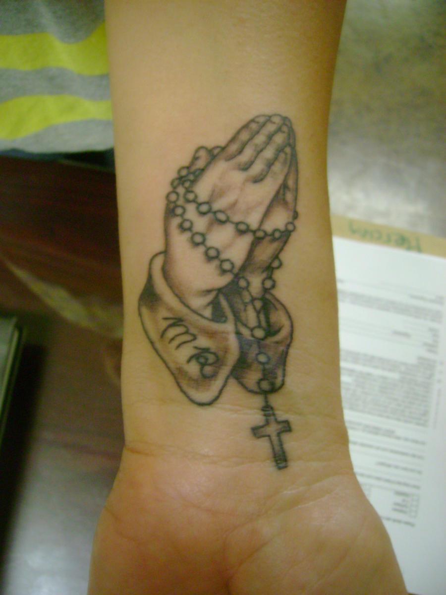 praying hands wrist tattoo