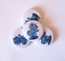 Baby Blue Dragon pinback badges and needle minders