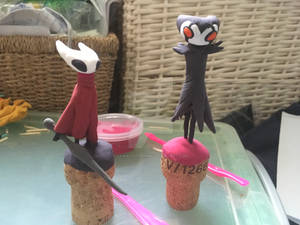 clay model: grimm and hornet from hollow knight