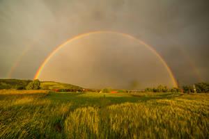 Double rainbow and Slovenian rural landscape