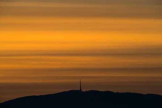Orange sunrise over Trdinov vrh in Slovenia