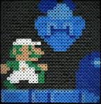 Luigi knocks out Goomba