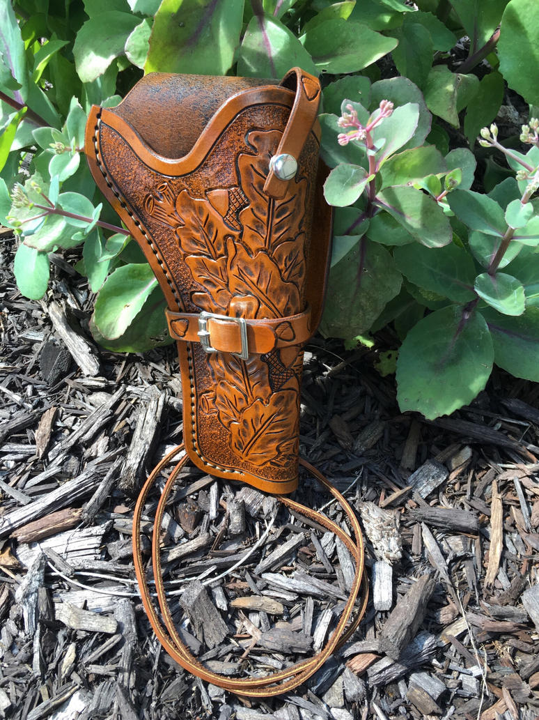 Hand carved  tooled leather holster  by Jleather