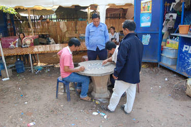 Lao men playing draughts by weddige
