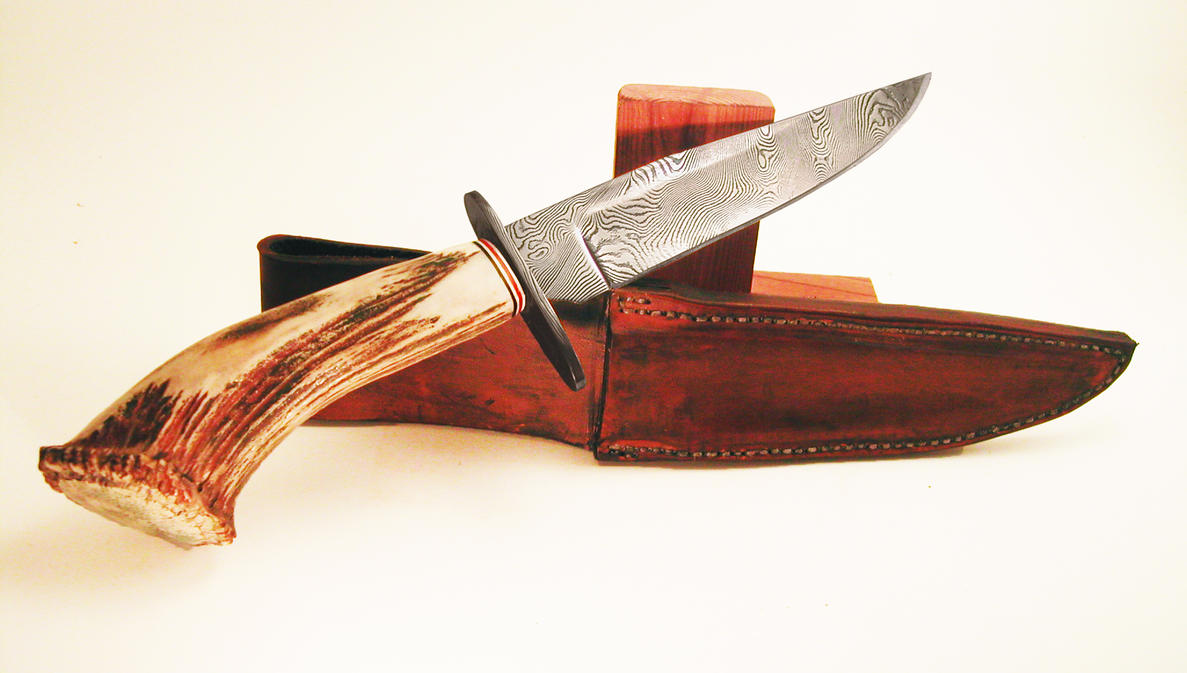 Elk Antler Damascus Hunting Knife by wolfofragnarok