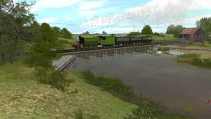 Henry rush passes a small lake bridge...