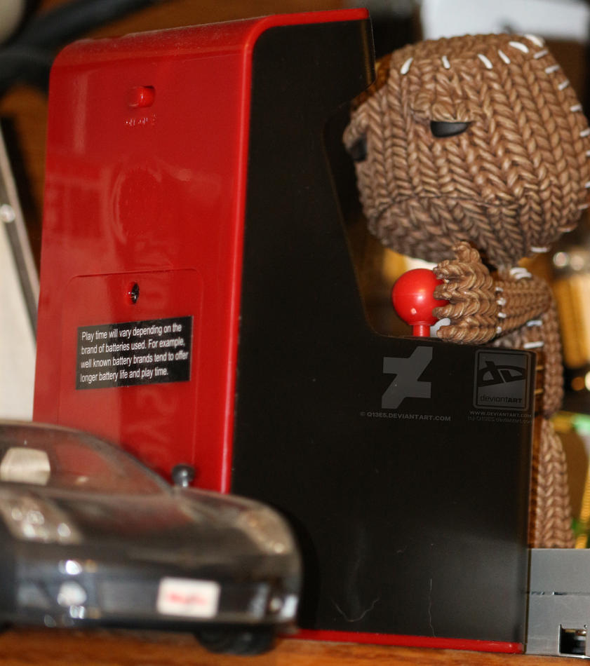 Sackboy plays disappoint bootleg arcade games. by Q13E5