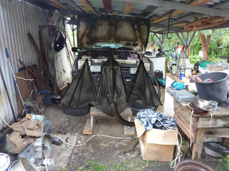 Dragon repairs old car