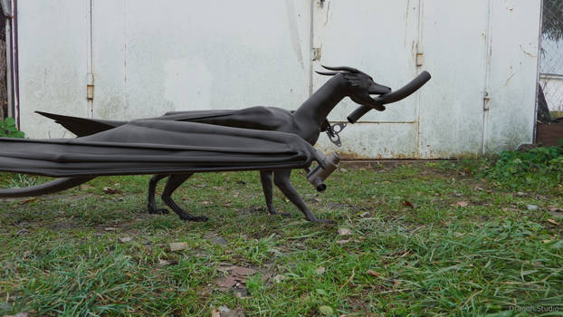 Dragon carries car parts