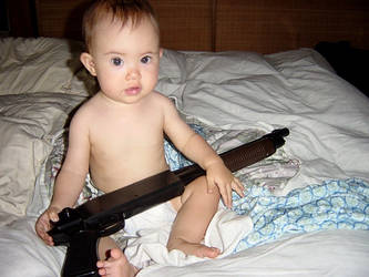 baby with a shotgun