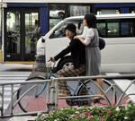 Tokyo Girl on Back of Bike