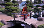 Red Kimono Lady with Blue Parasol over Bridge