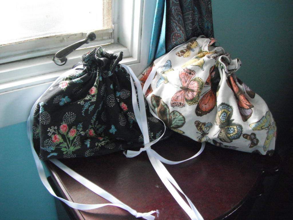 Bellatrix's bags by SinePerrell