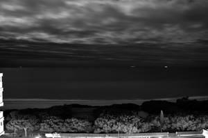 Deep black sea under a cloudy sky