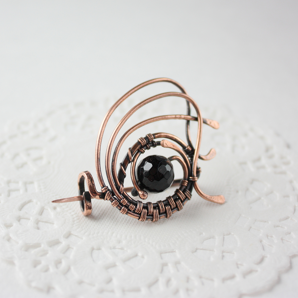 Black agate brooch by WhiteSquaw