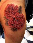 Red Roses on thigh tattoo