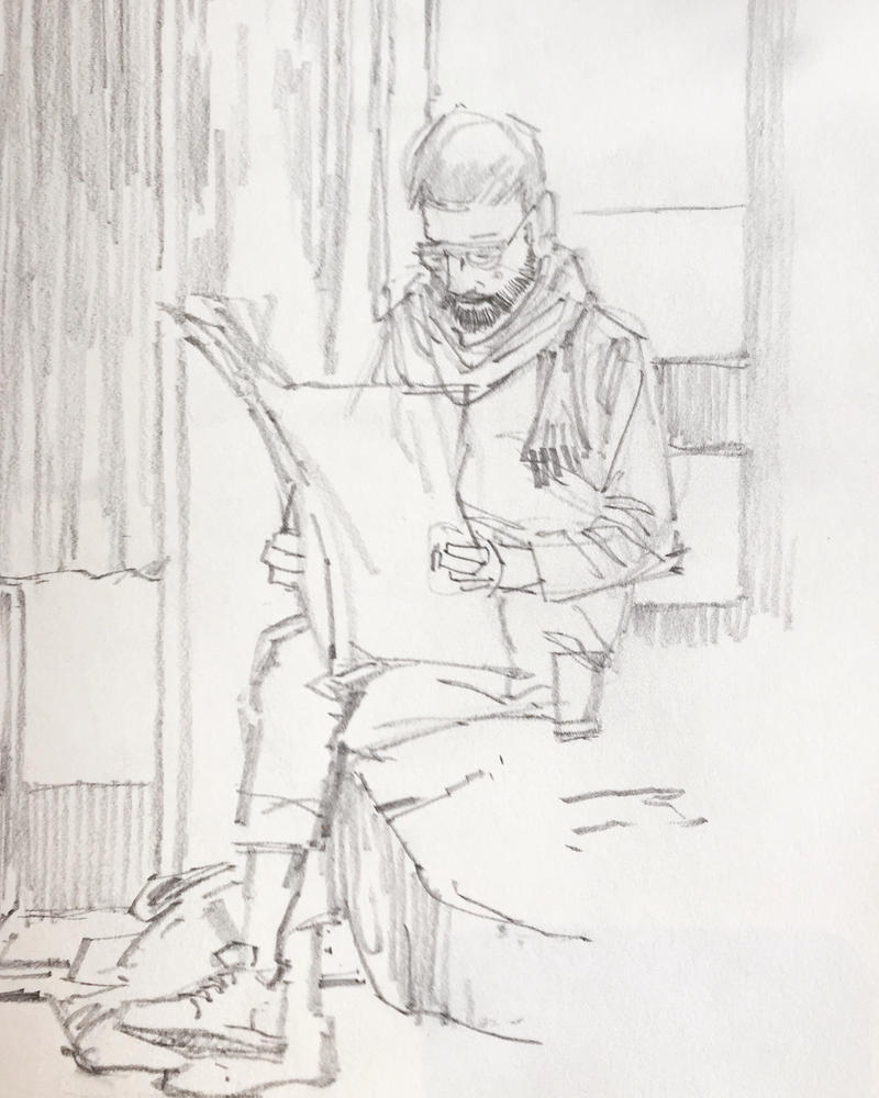 Man reading morning newspaper. by aminamat